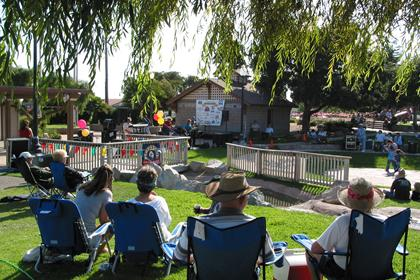 Locals and visitors enjoying the summer concert series at Ramona Garden Park in Grover Beach, CA